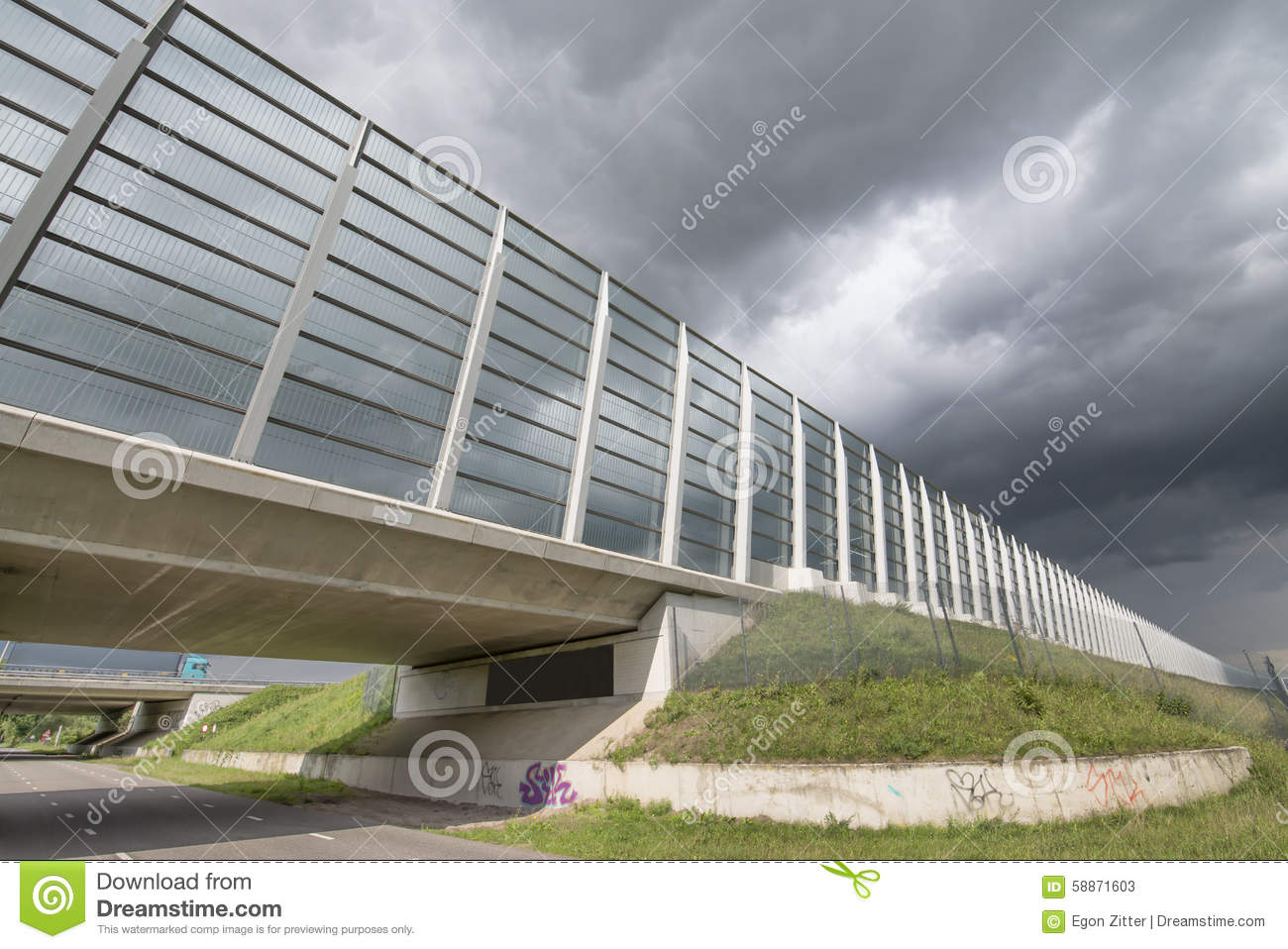 Noise barrier wall stock image of road traffic