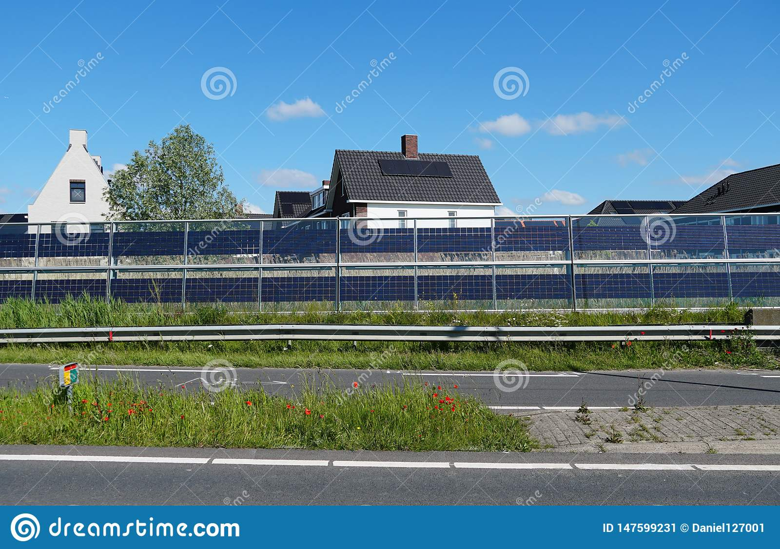 Noise barriers with integrated solar panels