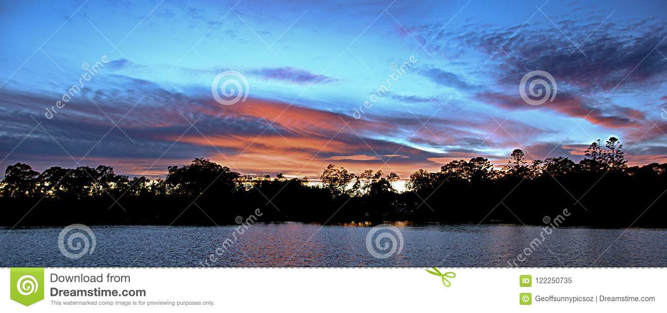 Red colored cirrostratus cloud, sunset seascape.