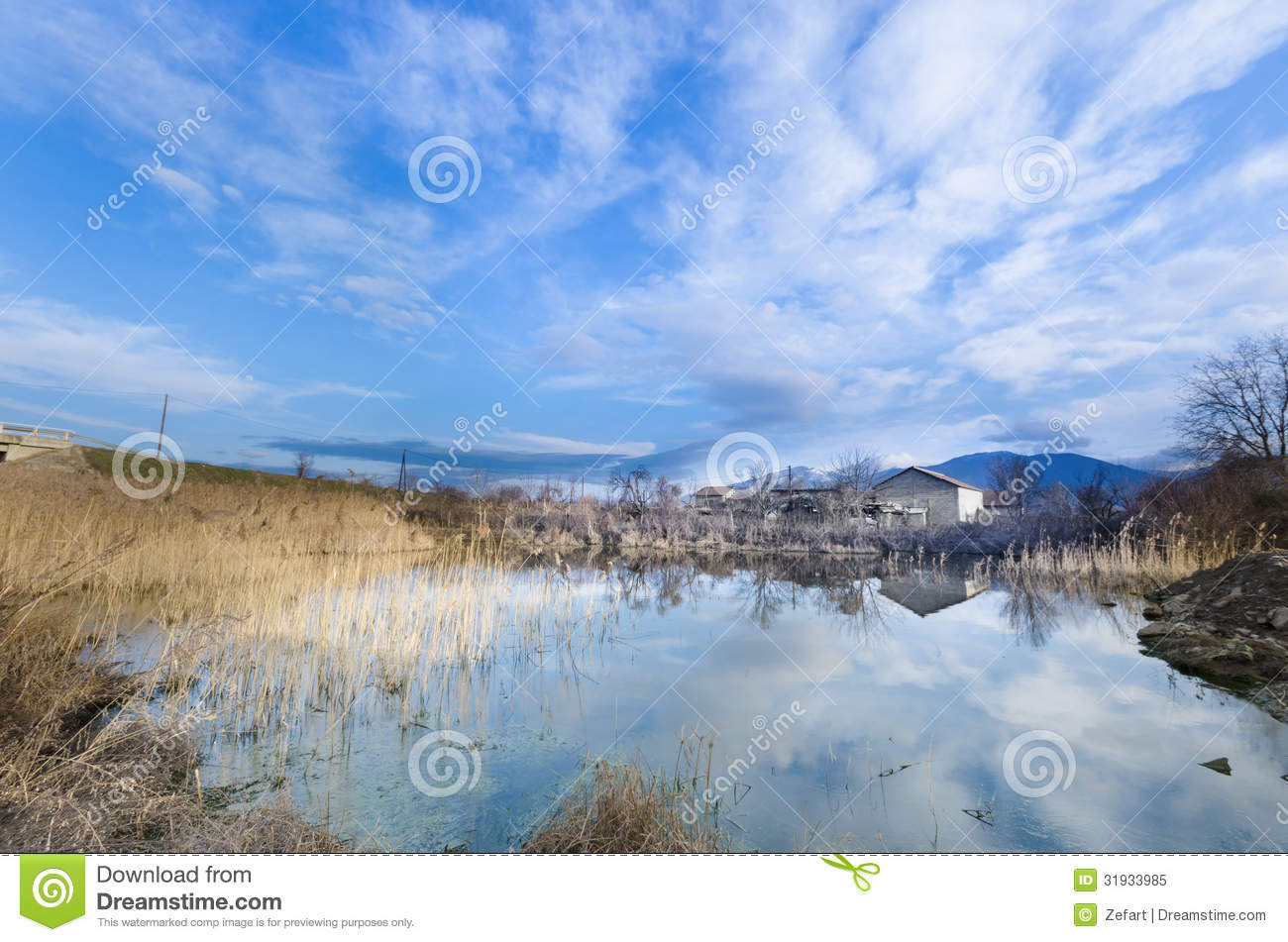 Non urban landscape small lake reflection royalty free for Building a small lake