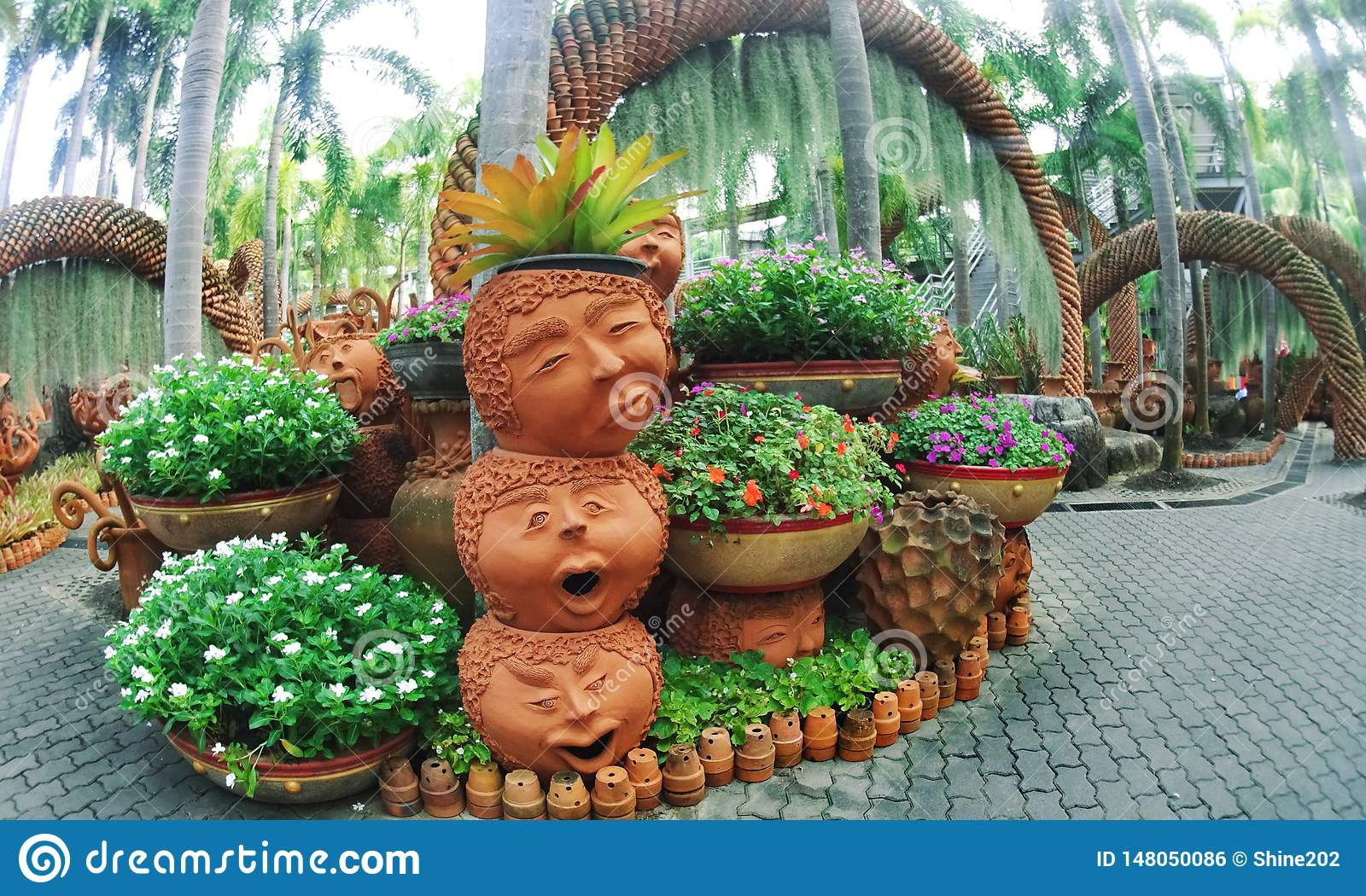 Nong Nooch Park Pattaya with an unusual landscape design of ceramic pots in the form of funny faces and lots of greenery
