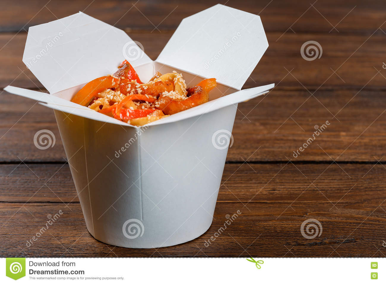 Noodles in a white box on wooden background