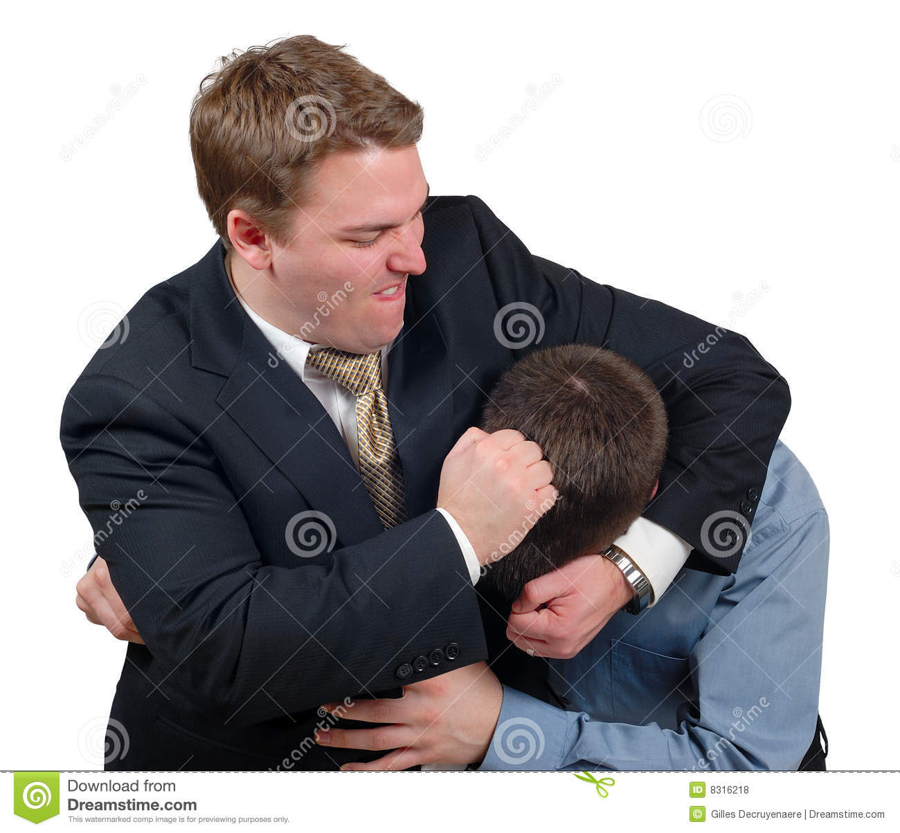 Young man in a business suit giving a noogie to another young man in a ...