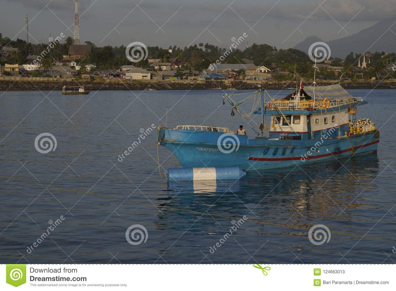 Fishing Boats Lean in Shallow Waters