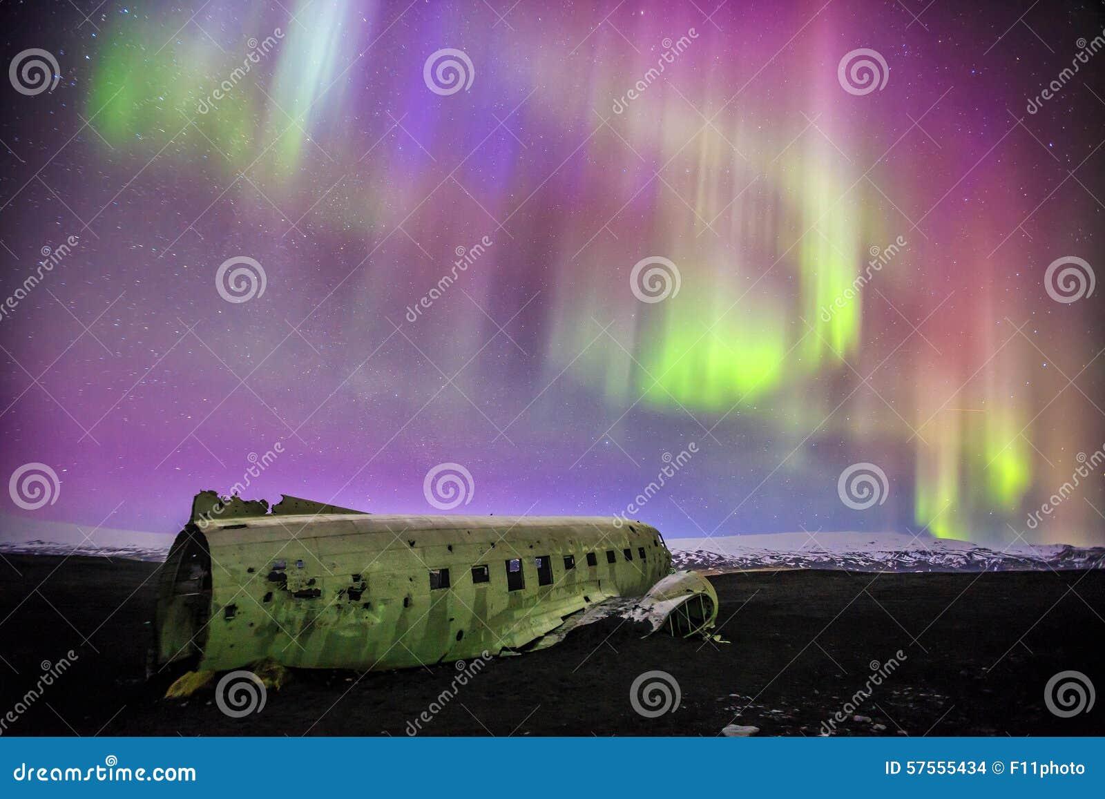 Northern lights over plane wreck in Vik, Iceland