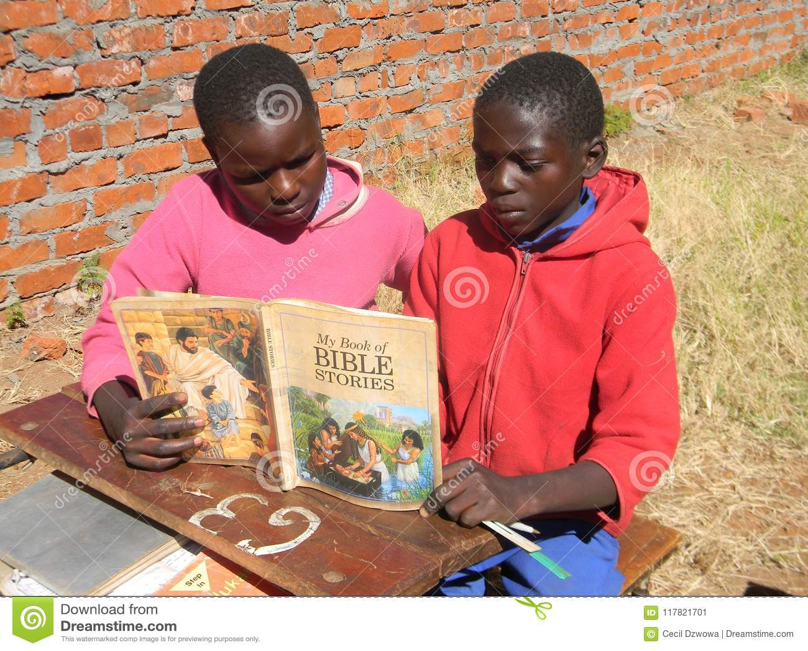 African Children Reading A Bible Stories Book Editorial