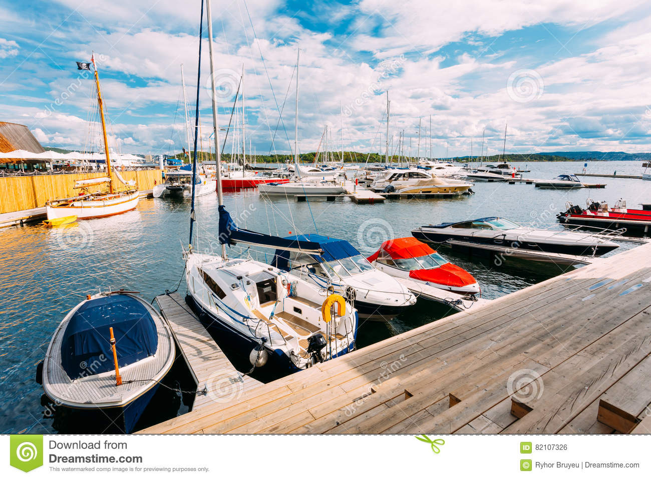 Norway, Oslo, Aker Brygge District. Wooden Sea Pier With Moored Boats Stock Photo - Image of ...