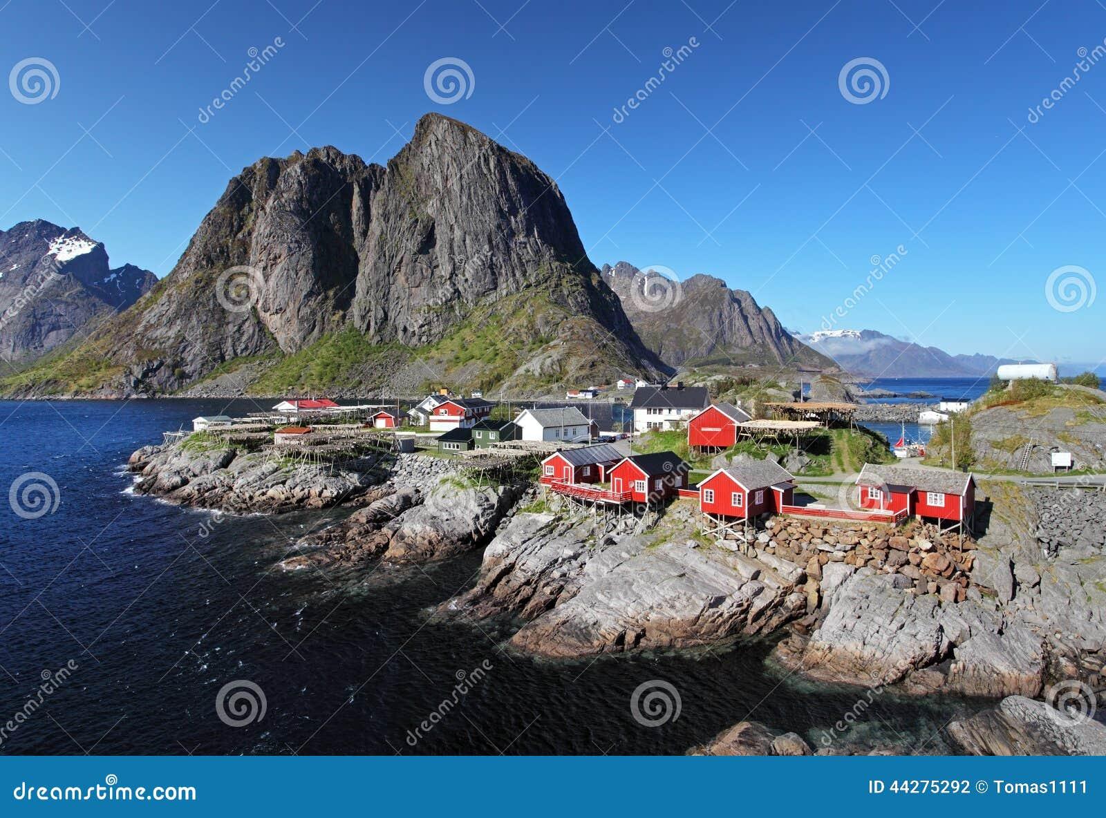 Norwegian fishing village with traditional red rorbu huts, Reine, Lofoten Islands, Norway