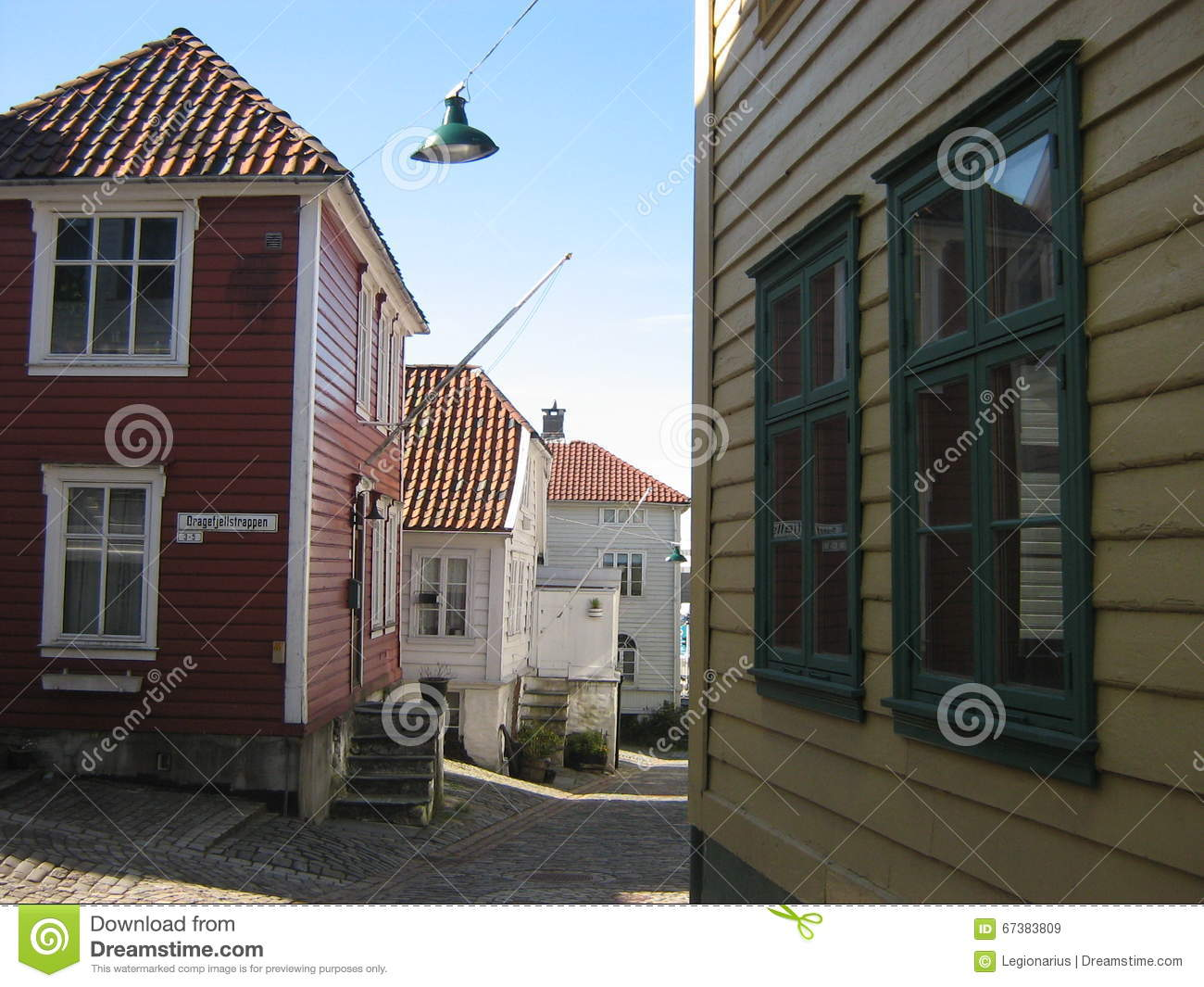 Colored norwegian wooden houses and a street lamp in for Norway wooden houses