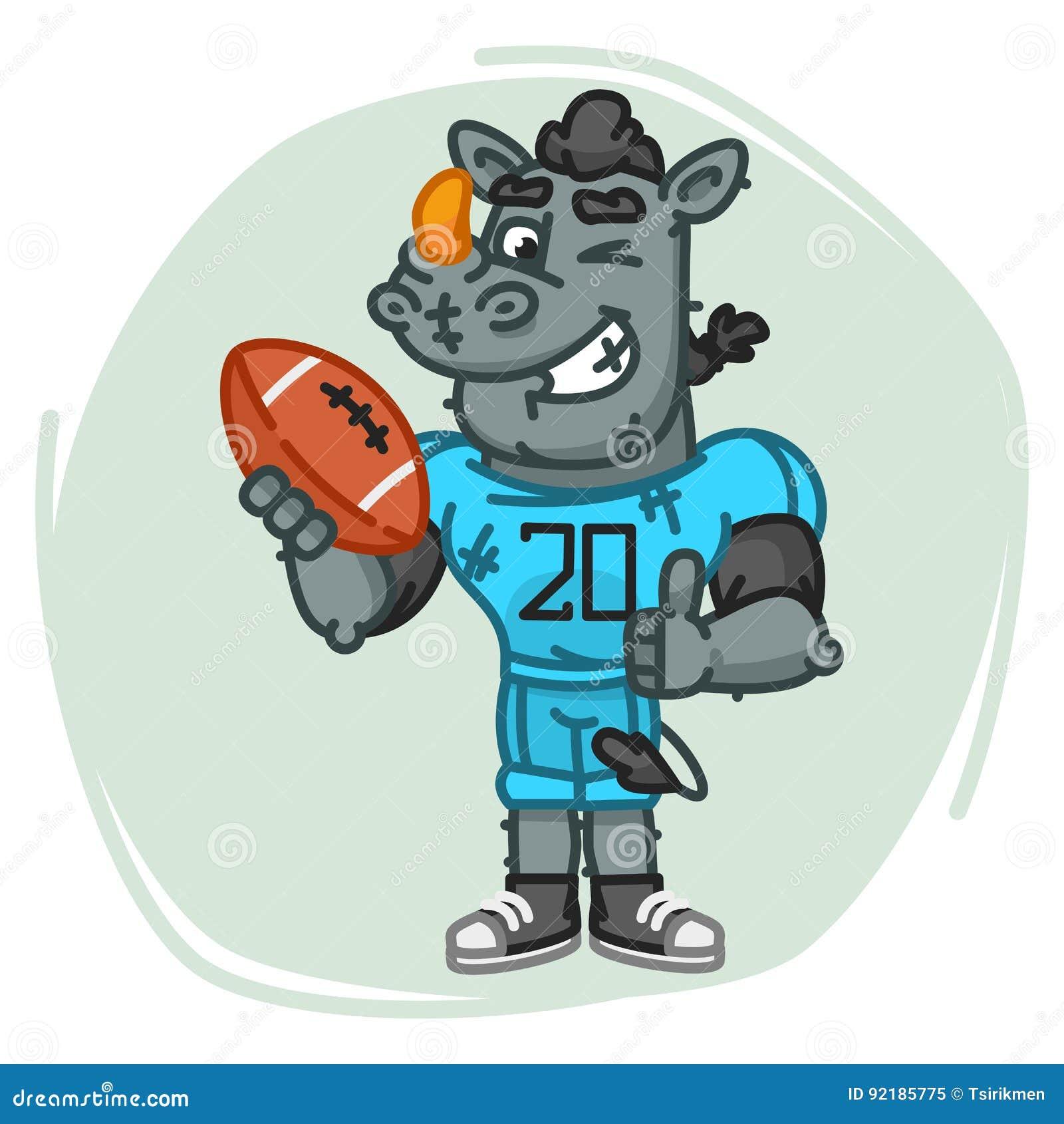 Nosorożec gracz futbolu Trzyma Balowe przedstawienie aprobaty, mrugnięcia i