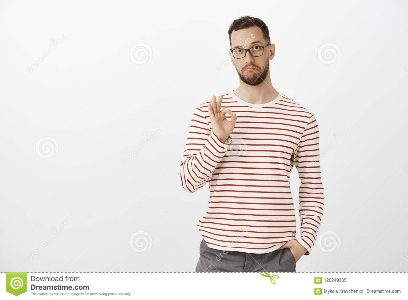 Not bad, like your idea, good job. Satisfied impressed attractive mature guy in glasses and striped clothes, showing ok