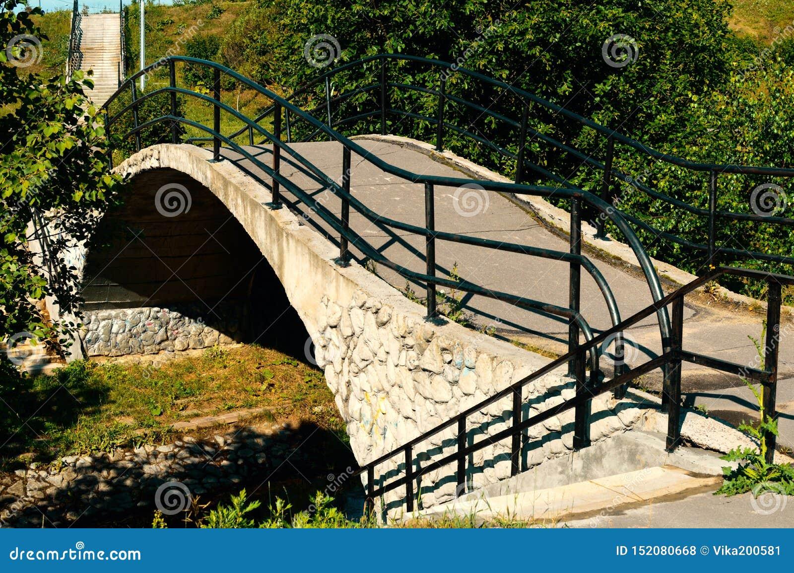 Stone Bridge over little river in the city park