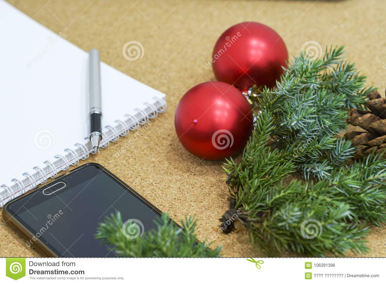 download not completed list of goals in a notebook on a wooden table with christmas decorations