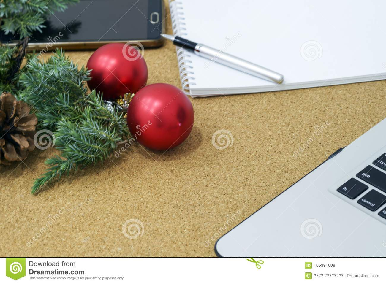 download not completed list of goals in a notebook on a wooden table with christmas decorations - Christmas Decorations List