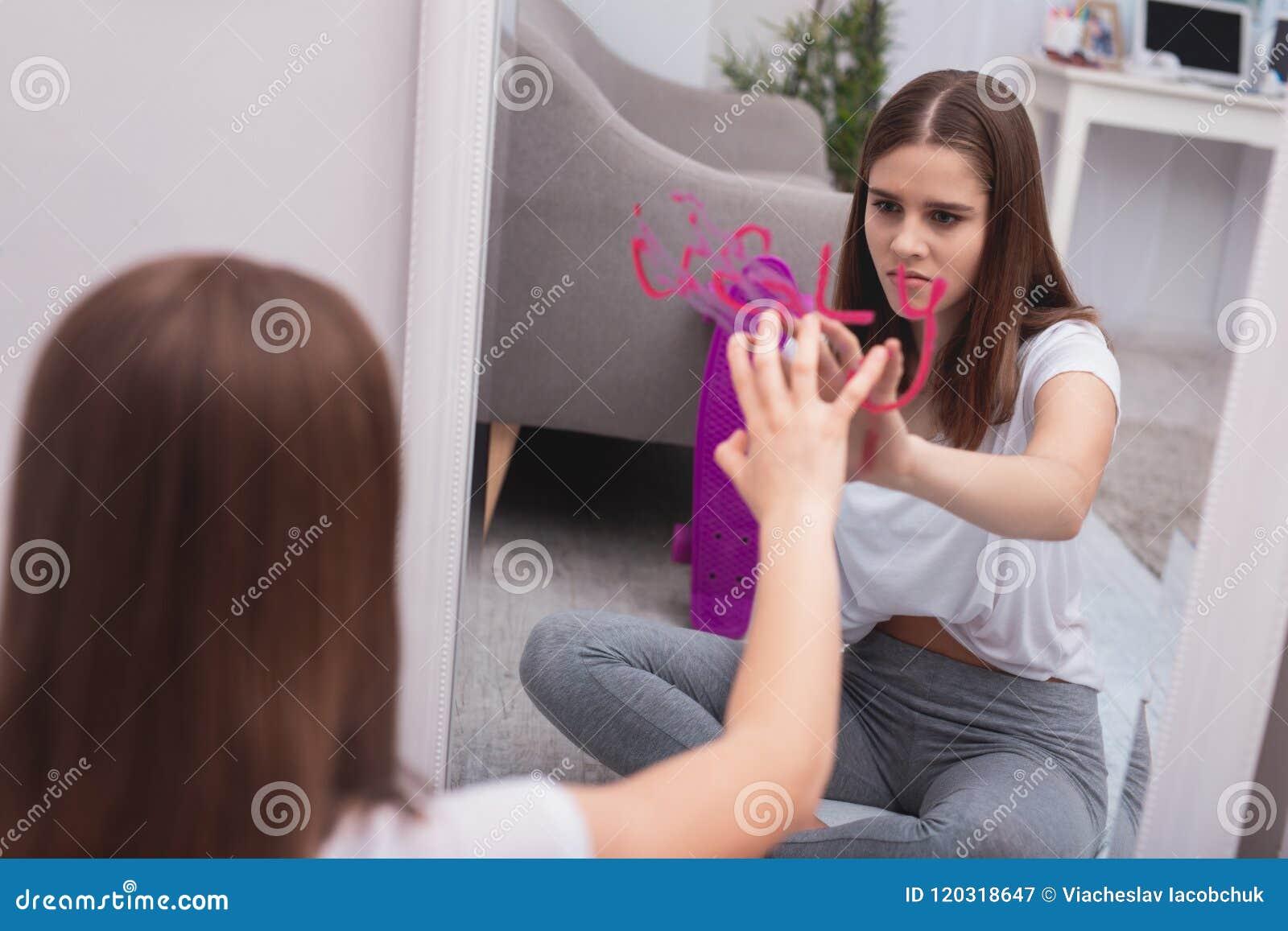 Upset teen girl overcoming complex