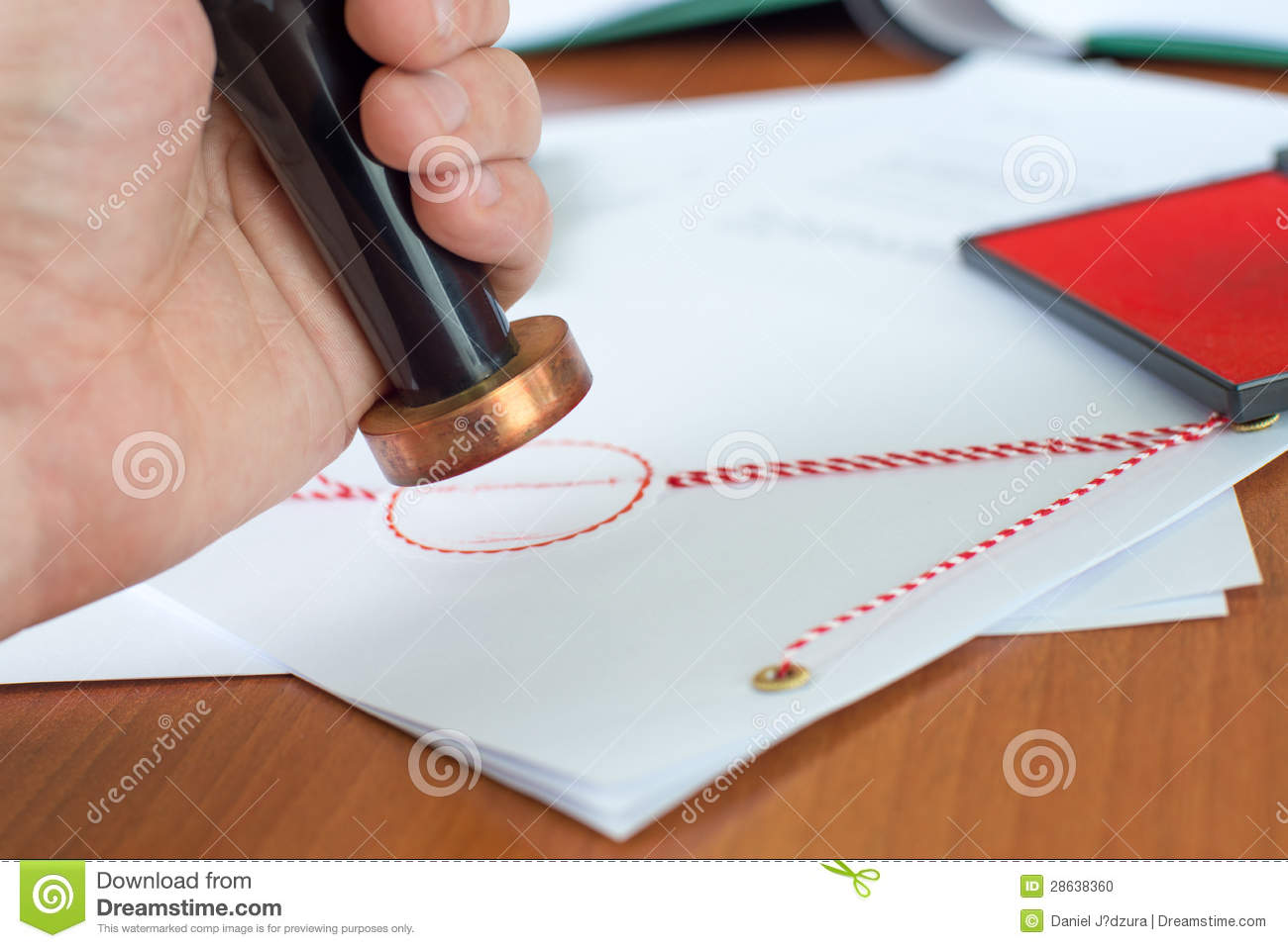 Notary public stamping a document