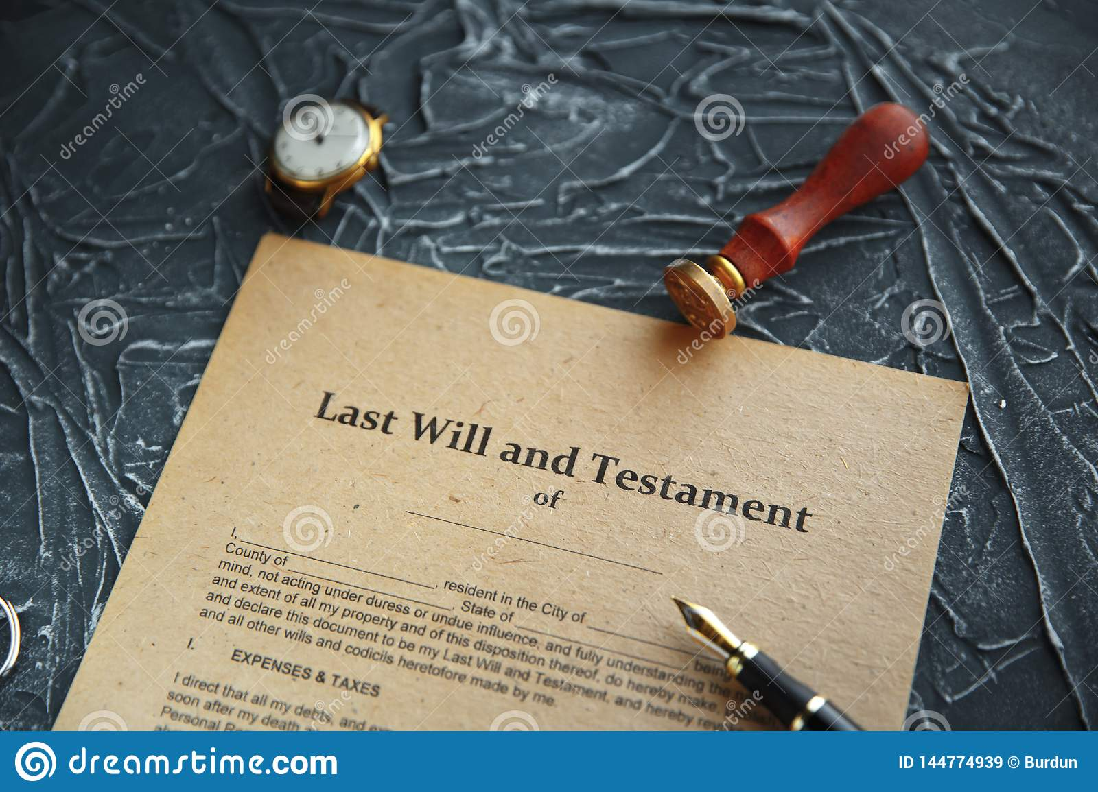 Notary`s public pen and stamp on testament and last will. Notary public