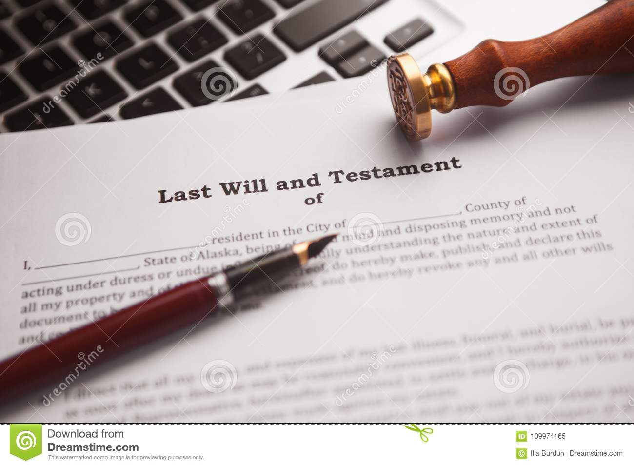 Notary`s public pen and stamp on testament and last will.