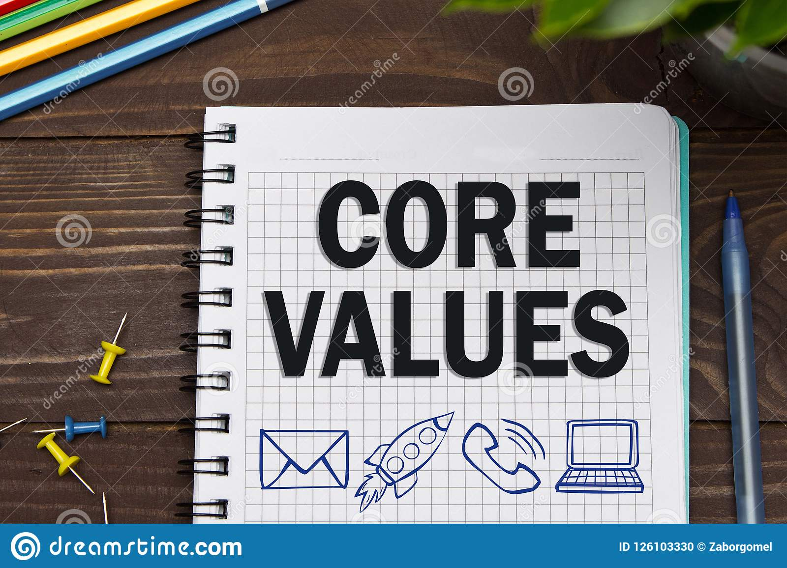 Notebook with a Business notes CORE VALUES on the office table w