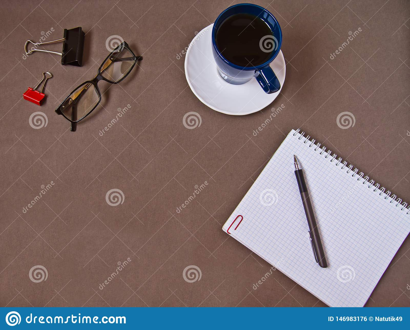 Notebook, coffee Cup, glasses, office supplies