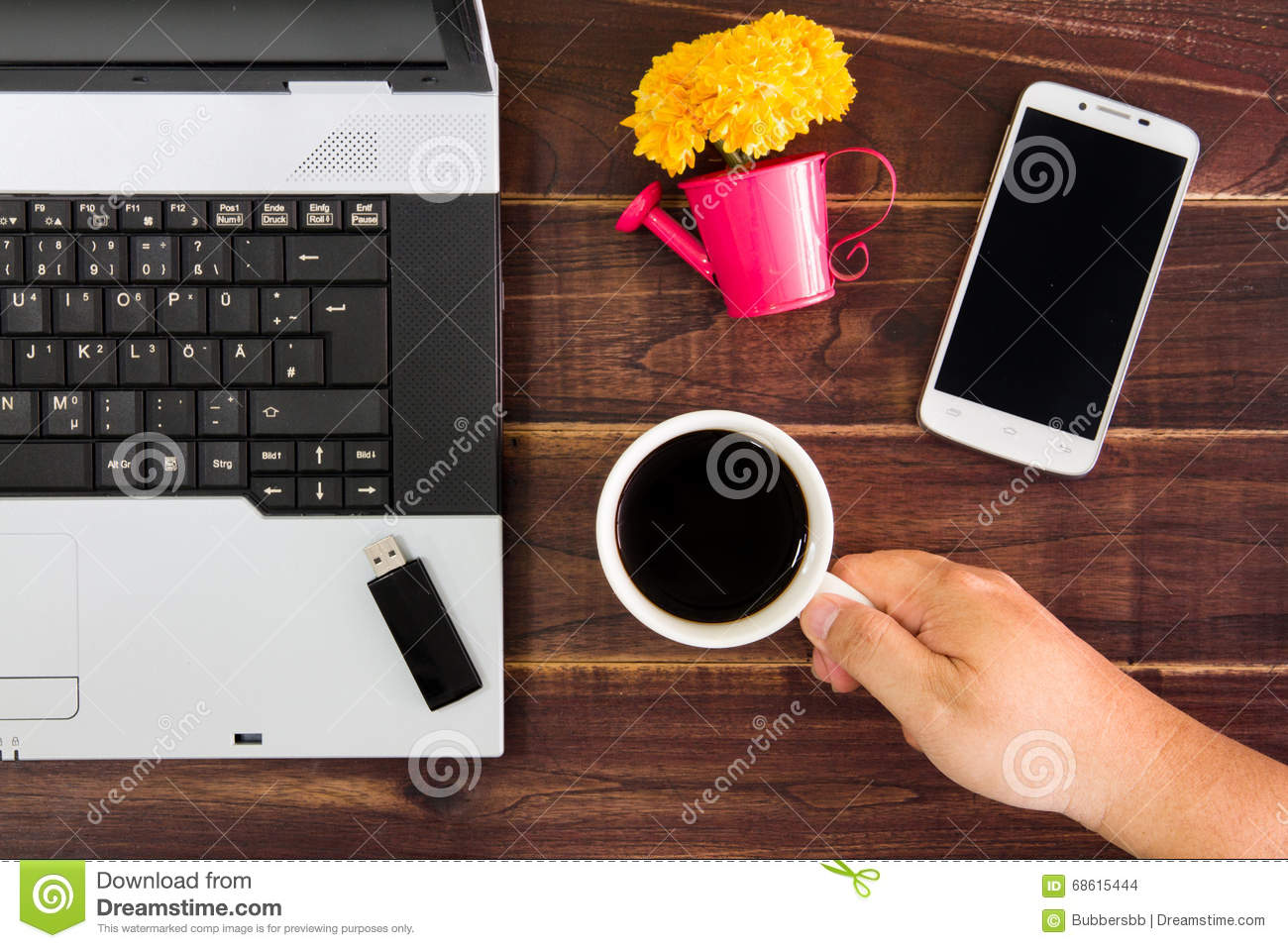 Notebook computer on the desk.USB flash drive stick,coffee cup,smartphone