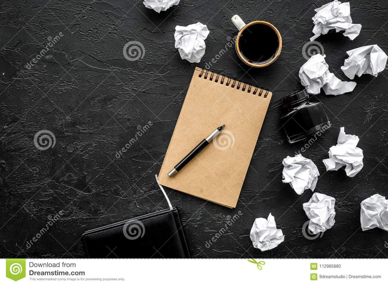 Notebook, ink, dip pen, coffee for writer workplace set on black office background top view mock-up