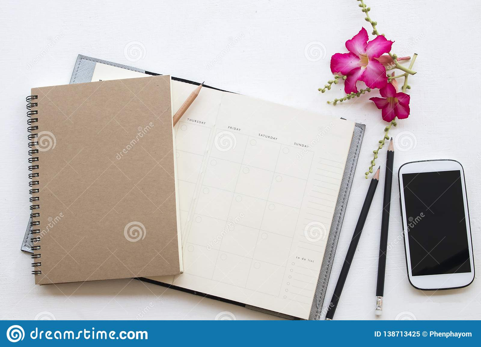 Notebook planner and mobile phone for business work