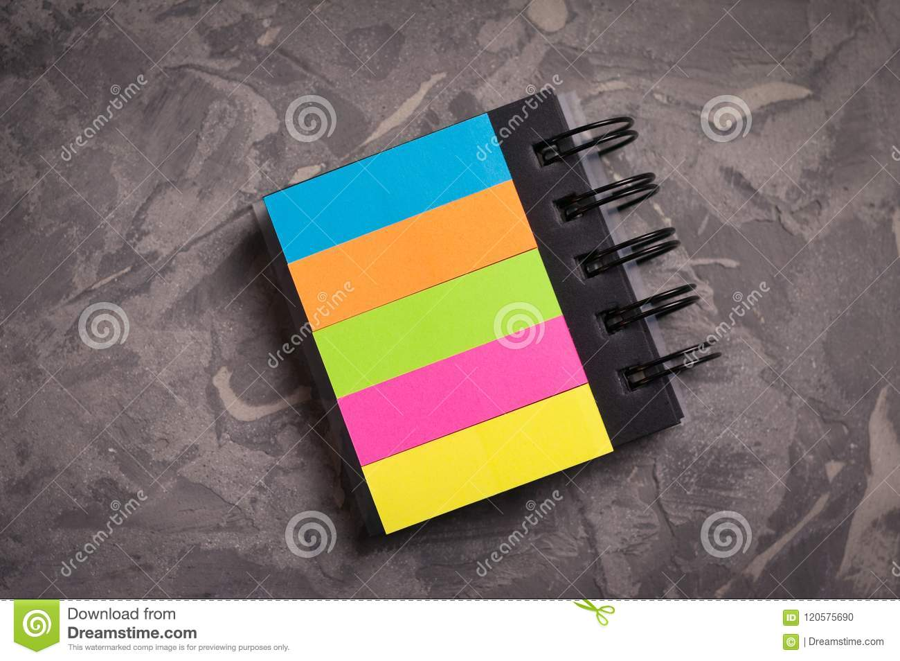 Notebook With Spiral And Blank Colored Pages On Old Concrete Gray