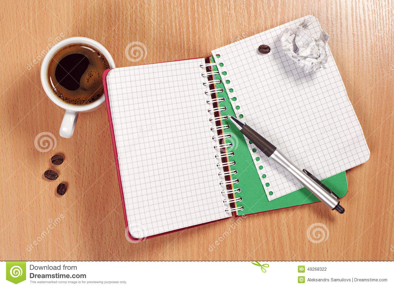 Notepad and coffee on desk