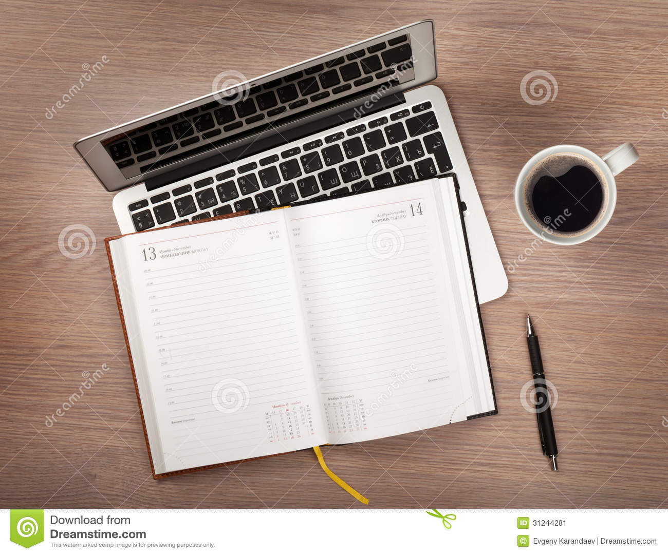 notepad, laptop and coffee cup on wood table stock photography
