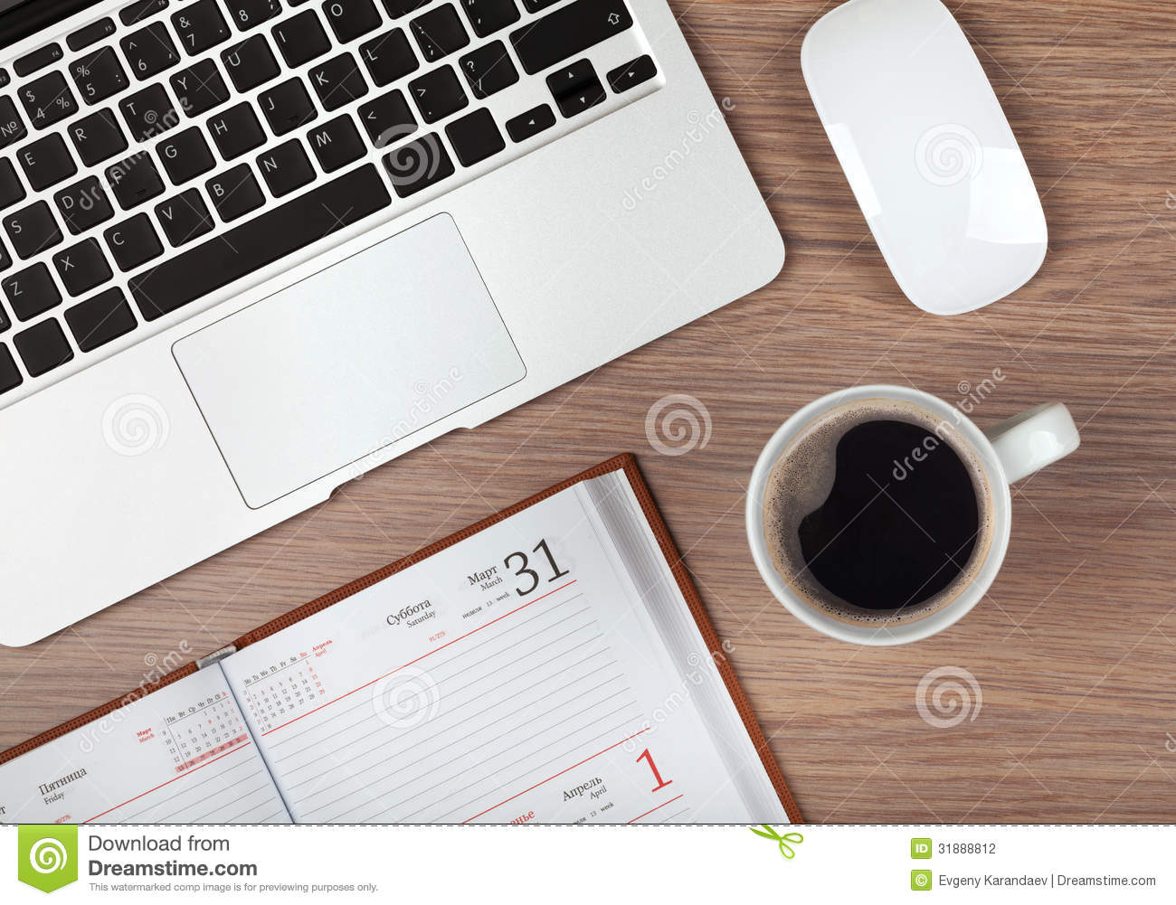 Notepad Laptop And Coffee Cup On Wood Table Stock