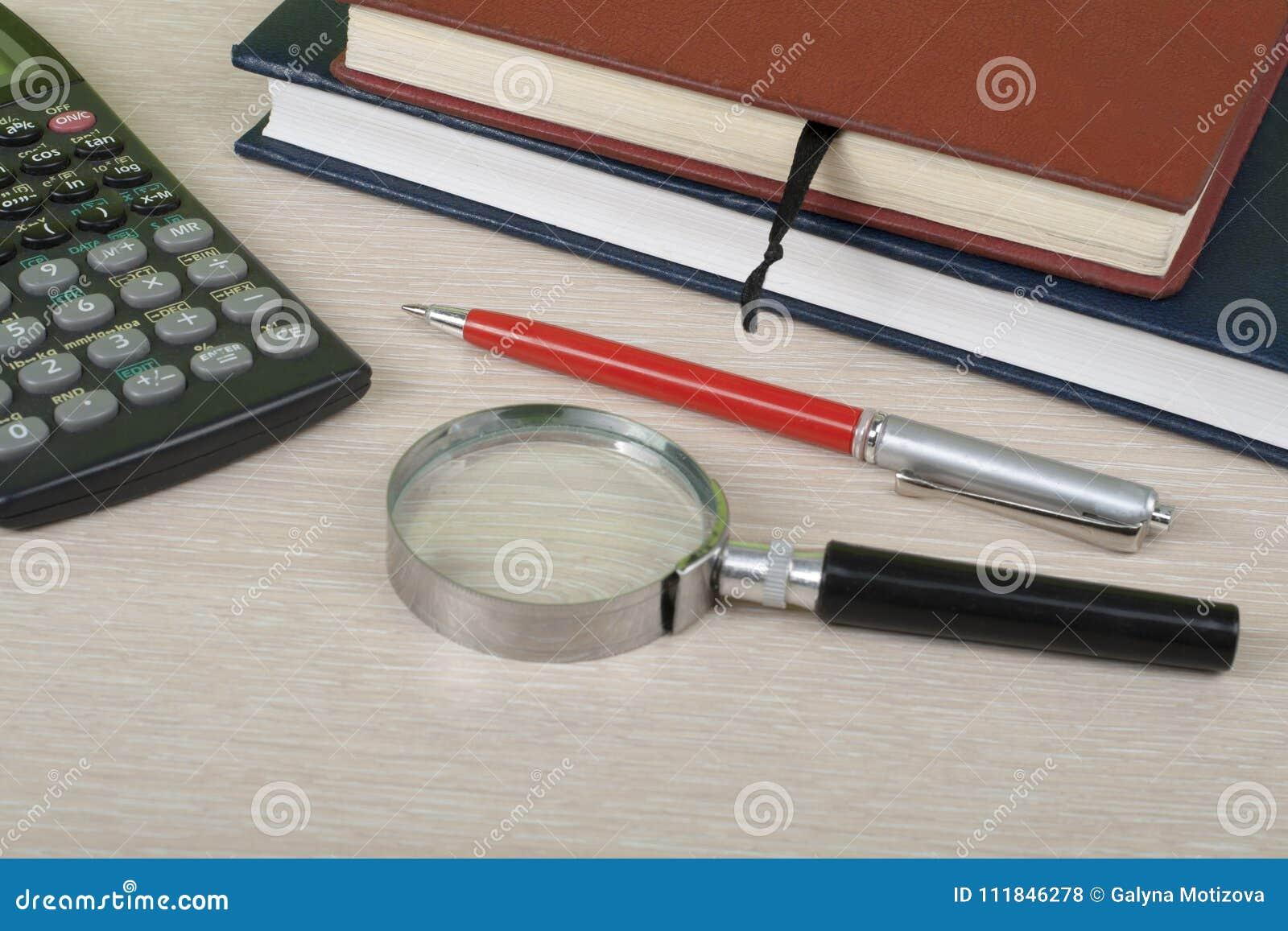home savings budget concept notepad pen calculator magnifying