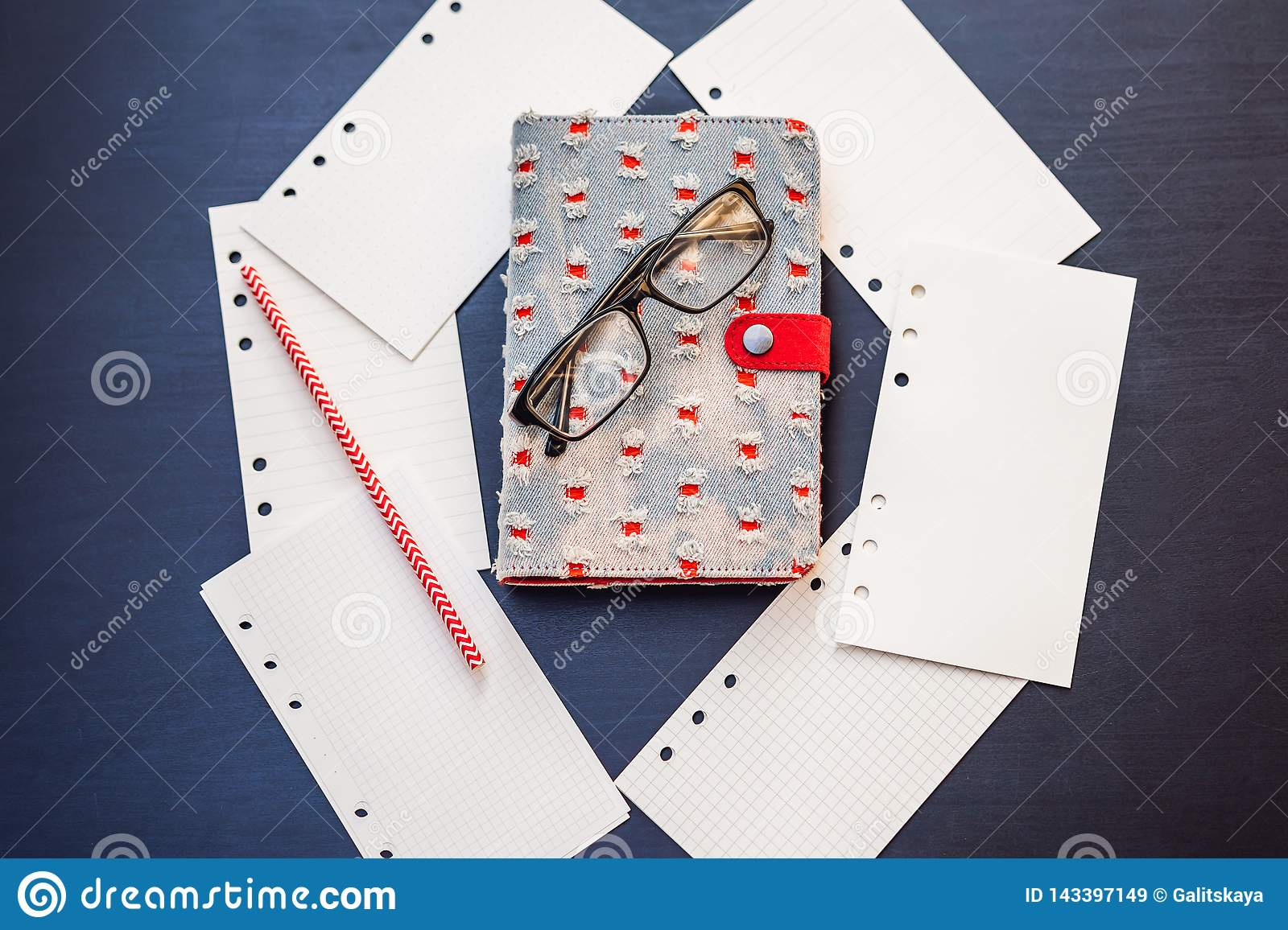 Notepad and stationery on a black background. Planner for business and study. Fans of stationery