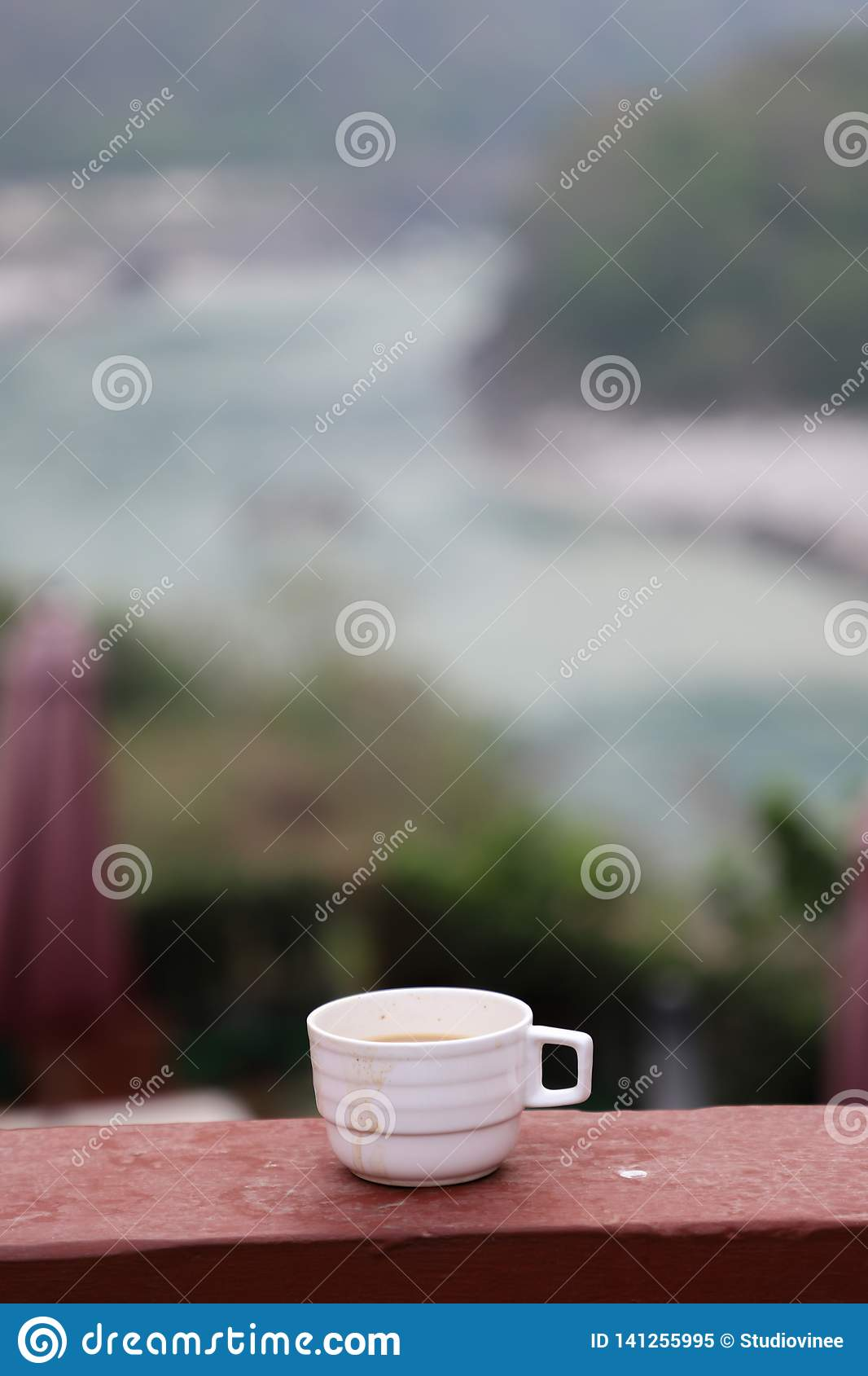 Hot cup of tea in a cloudy morning with the view