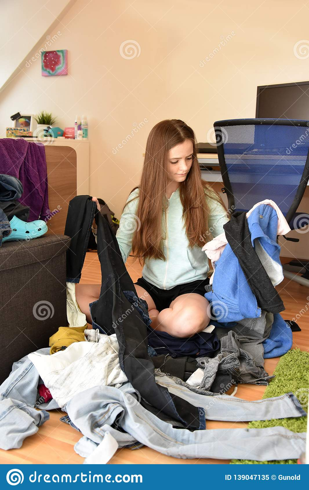 Frustrated Teenage Girl Choosing Her Outfit Stock Image - Image of