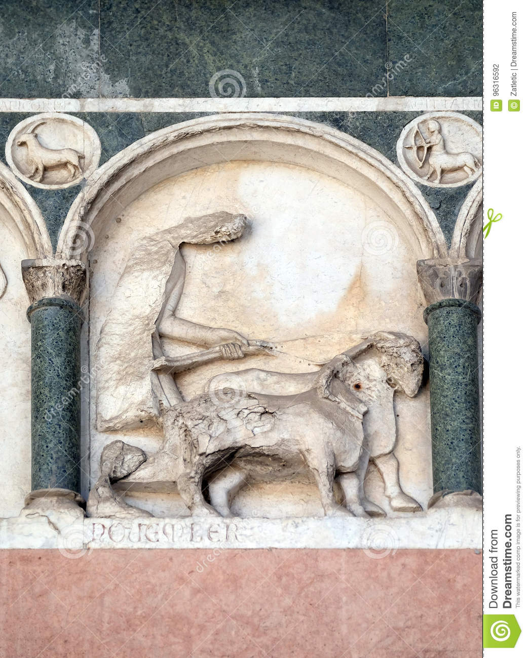 November, detail of the bass-relief representing the Labor of the months of the year, Cathedral in Lucca, Italy