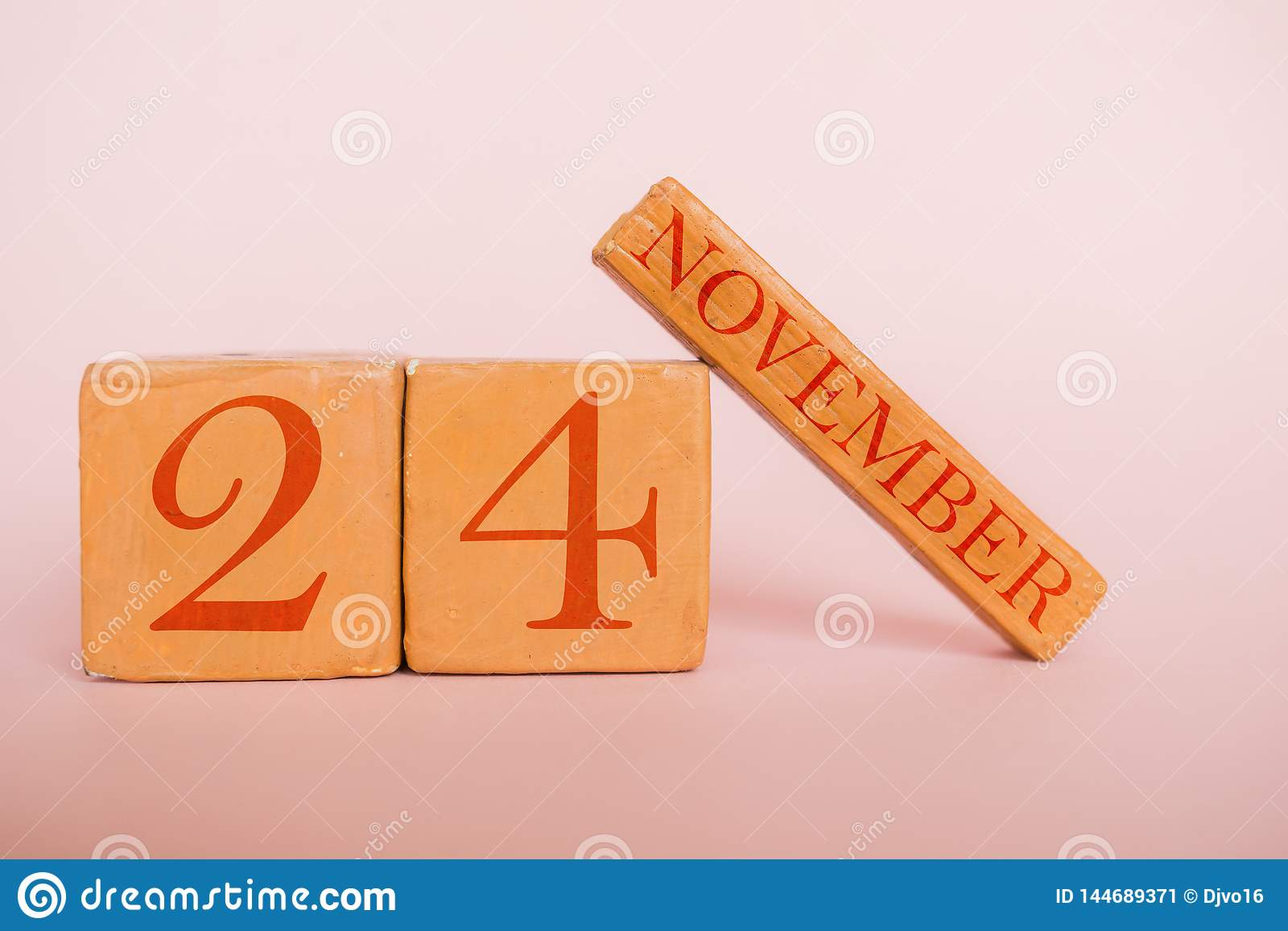november 24th. Day 24 of month, handmade wood calendar  on modern color background. autumn month, day of the year concept