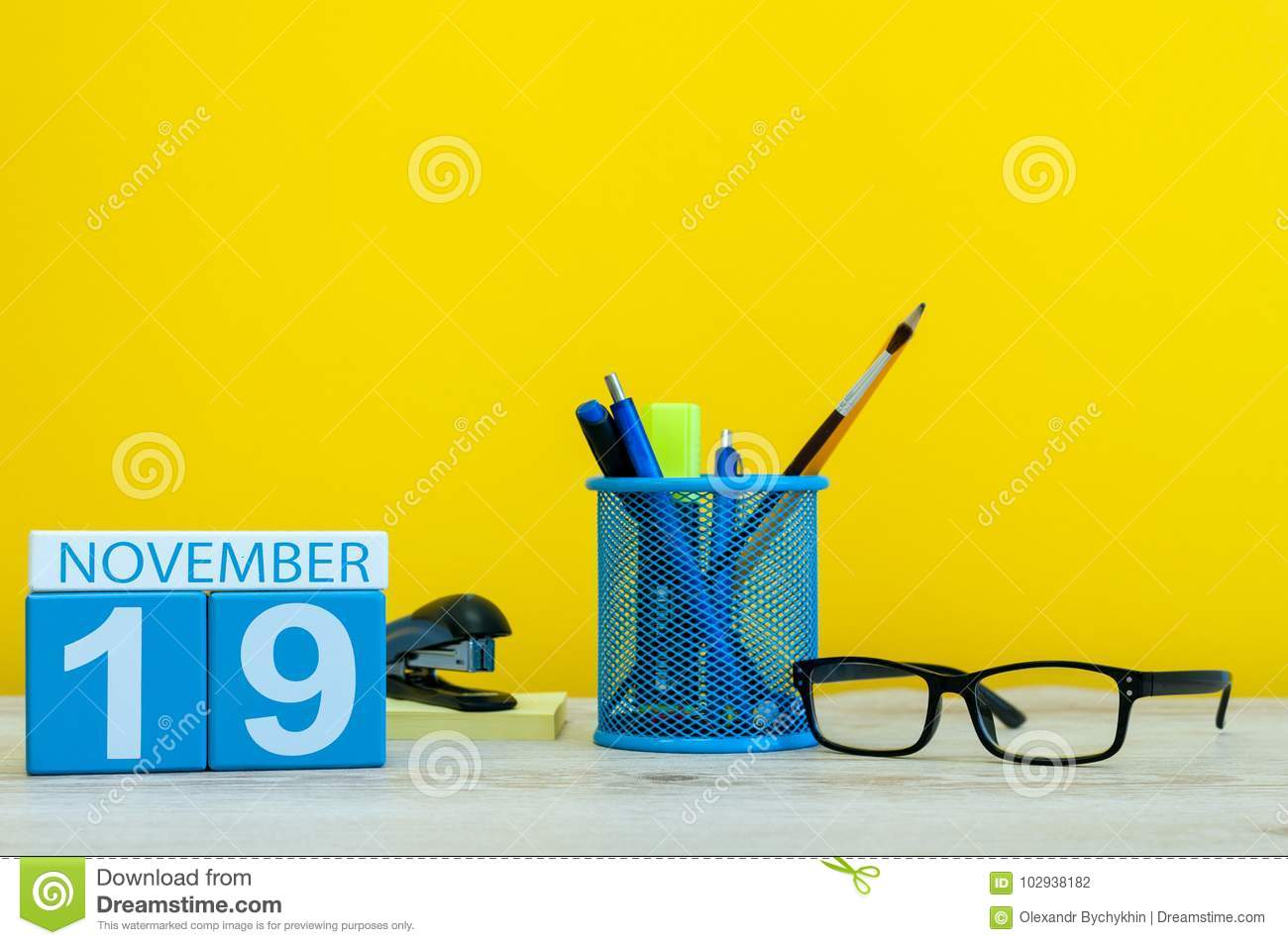 November 19th Day 19 Of Month Wooden Color Calendar On Yellow Background With Office Supplies Autumn Time
