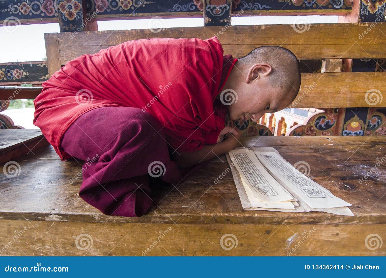 novice monk of Punakha Dzong , Bhutan , during chanting mantra