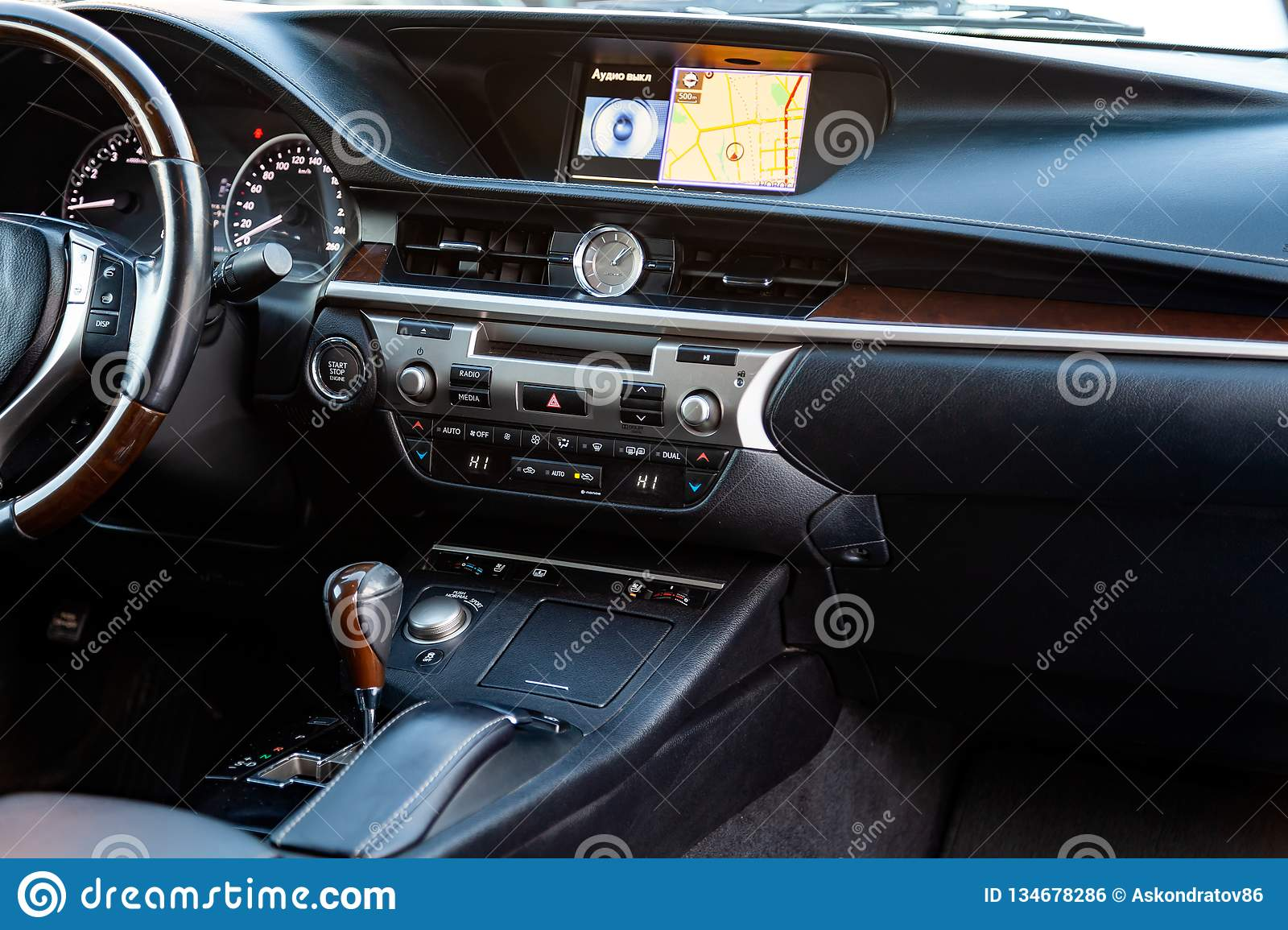 The Central Console Panel Inside A Black Car With Wooden And
