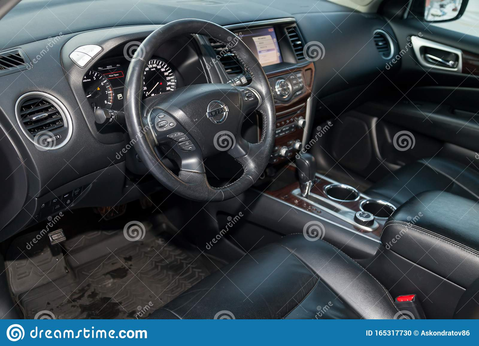 View To The Interior Of Nissan Pathfinder 2015 With Dashboard Clock Media System Front Seats And Steering Wheel After Cleaning Editorial Image Image Of Seat Dashboard 165317730