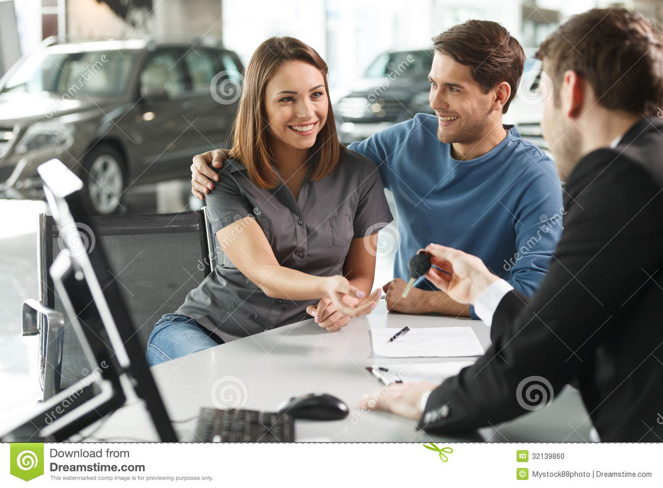 now her dream comes true  car salesman giving the key of