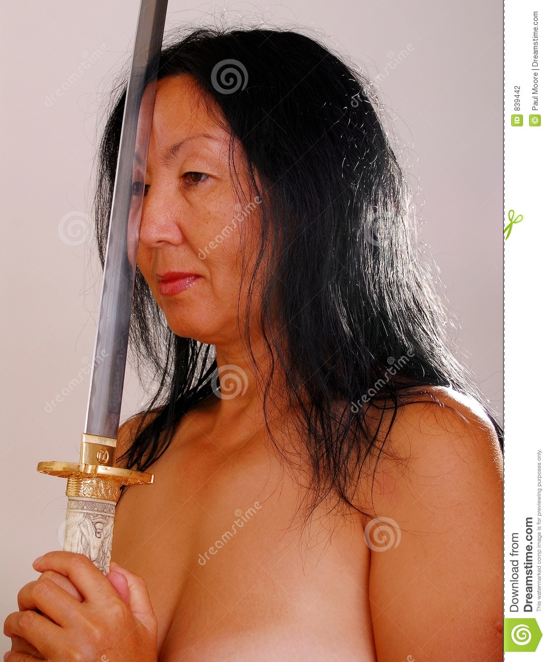 Half Body Portrait Of Nude Mature Asia Woman With Sword Studio