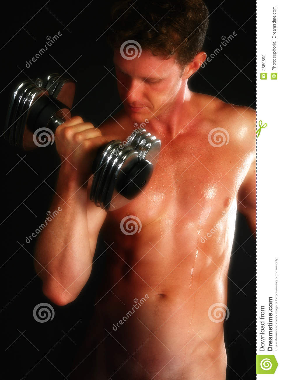 Attractive nude male lifting weights over black background.