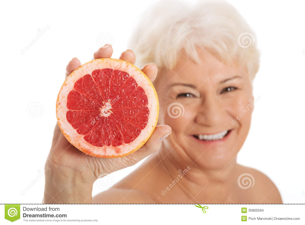 nude old woman holding a grapefruit stock images   image 35805594