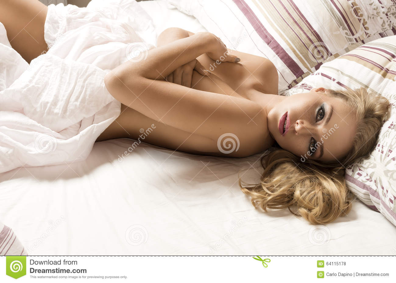 Hot girl covering naked body with hands Nude Sensual Girl On Bed Stock Photo Image Of Glamour 64115178