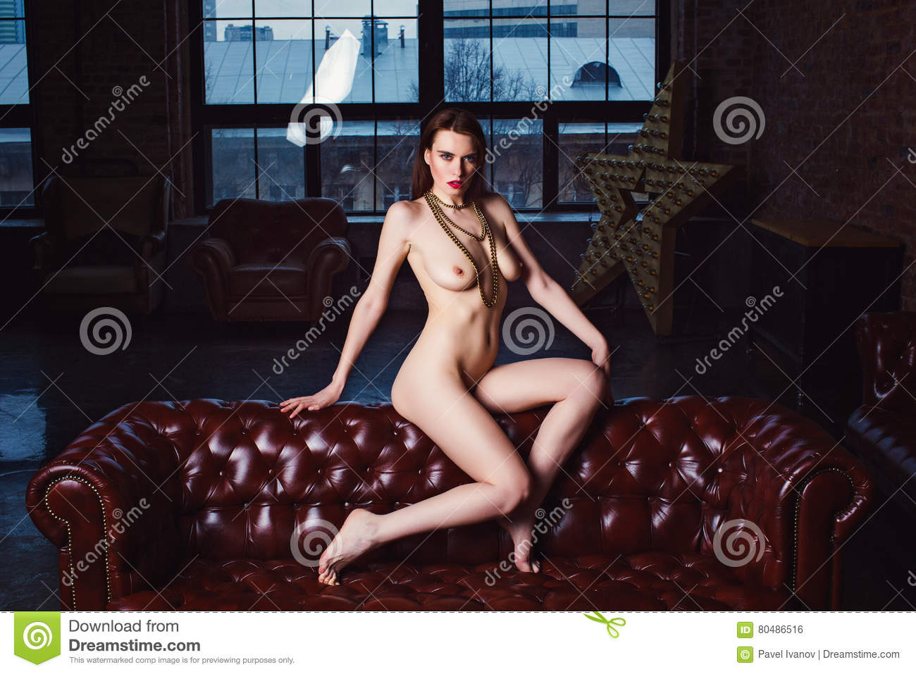 nude woman sitting couch