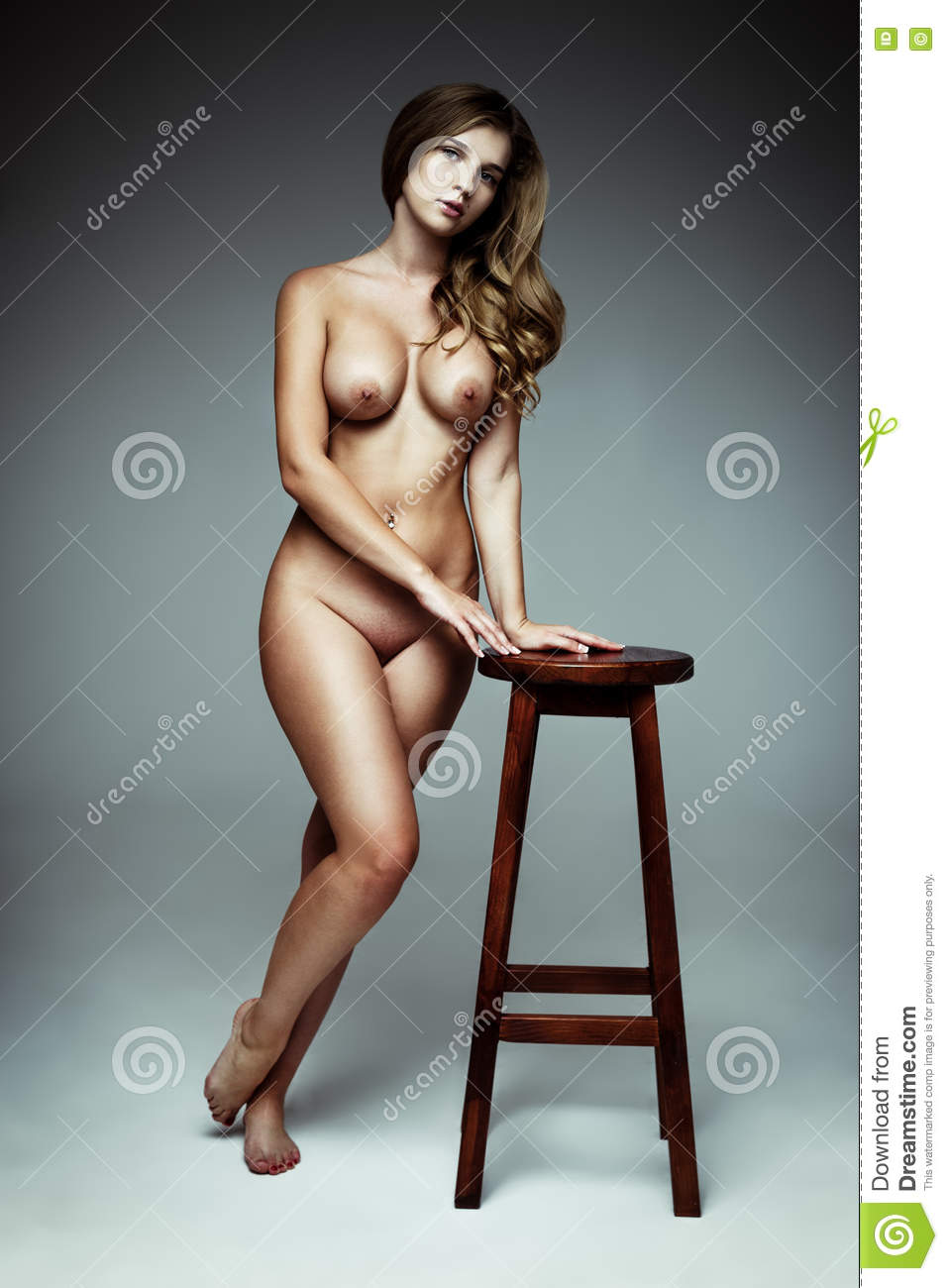 Nude Slim Body Of The Beautiful Woman With Long Hair Stock Photo