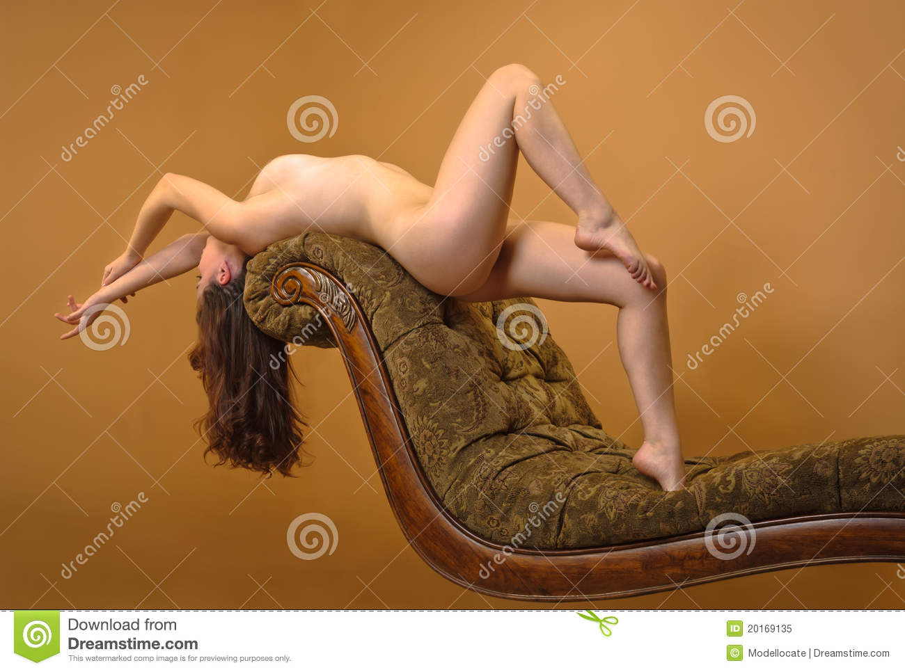 Royalty Free Stock Nude Woman Laying Over Back Of Couch