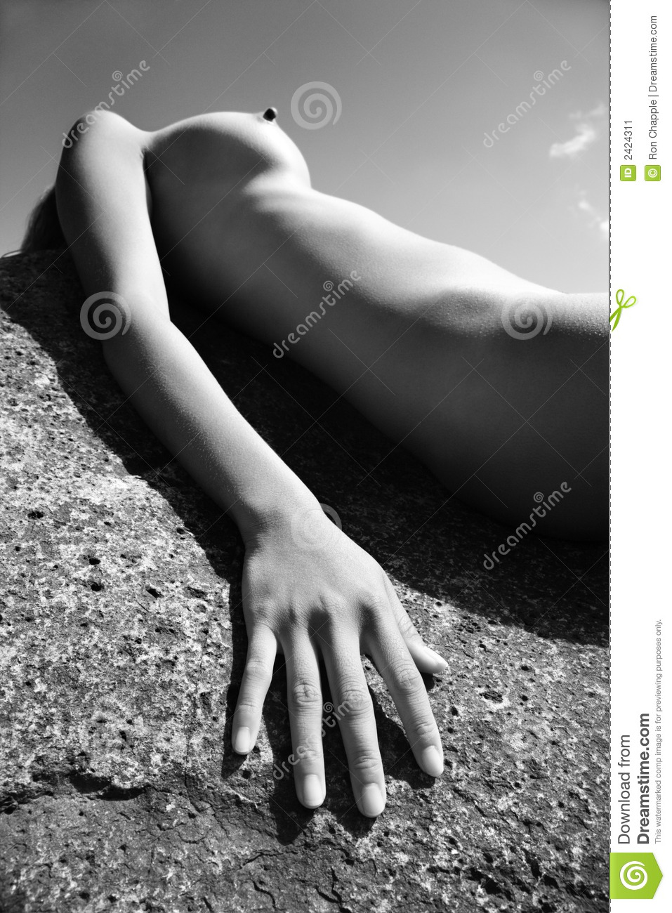 Young Nude Asian Woman Lying On Back Rock
